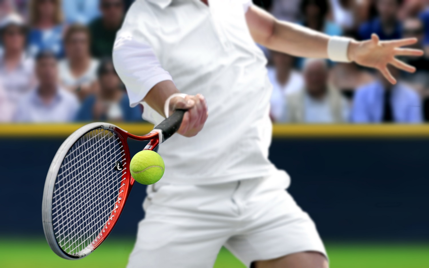 Male tennis player with forehand  racquet swing hitting ball
